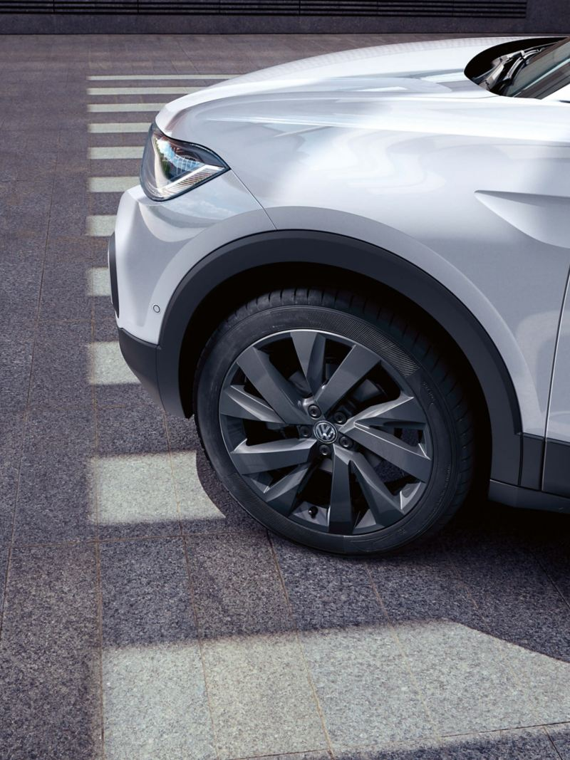 The front wheel of a white Volkswagen T-Cross