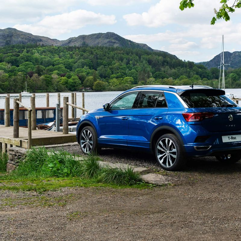 T-Roc parked in front of a large lake