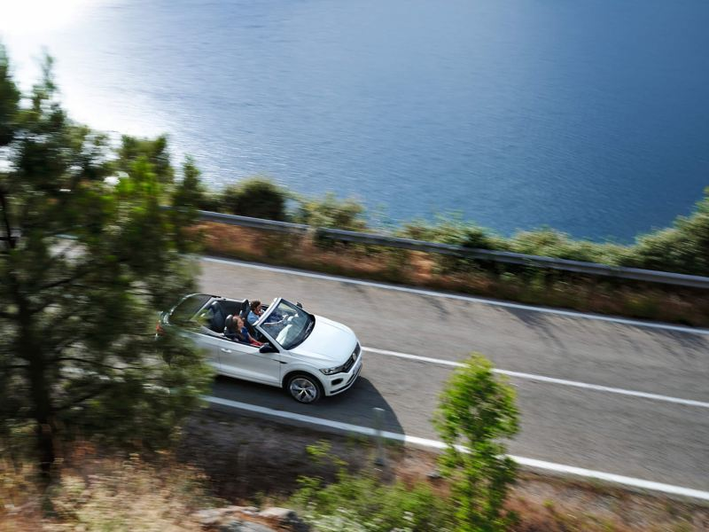 A T-Roc Cabriolet being driven on a coastal road