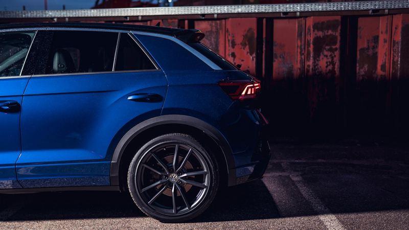The rear door and wheel of a blue Volkswagen T-Roc R