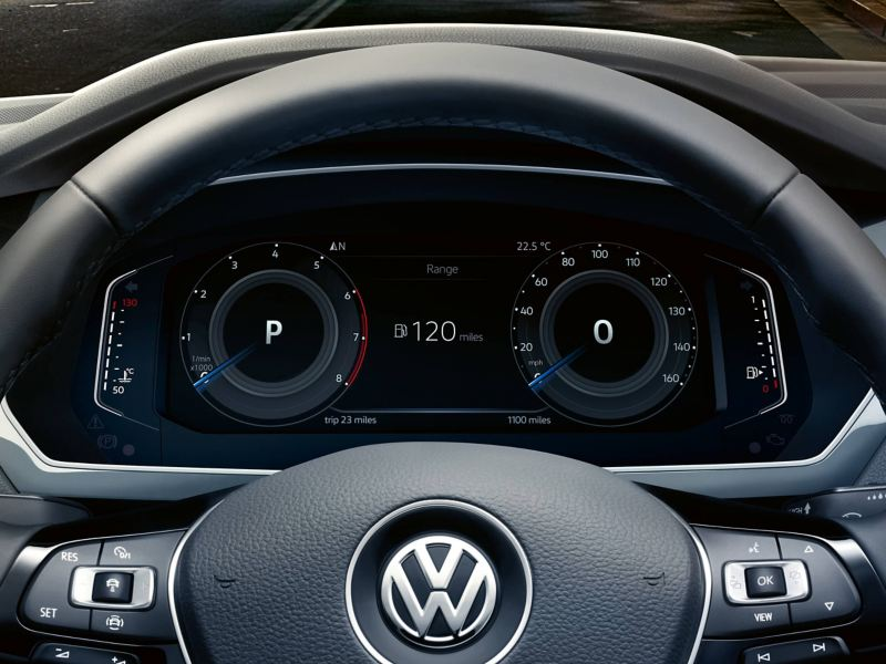A Volkswagen Tiguan's steering wheel and dashboard with the Active Info Display
