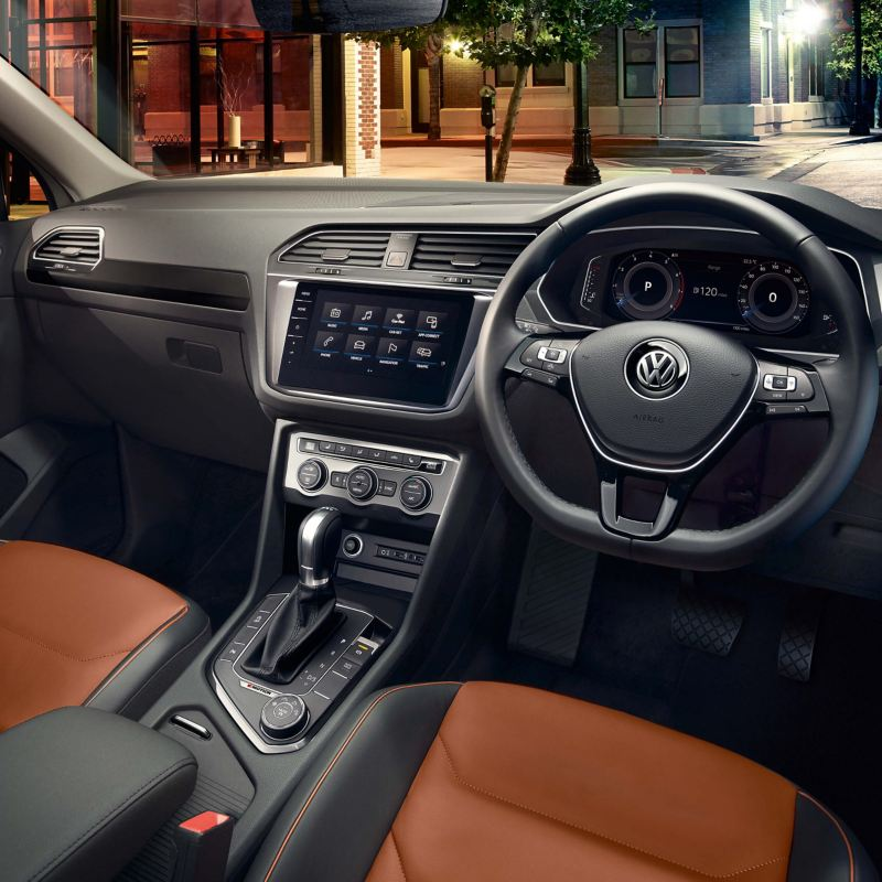 The front seats, steering wheel, dashboard and centre console of a Volkswagen Tiguan