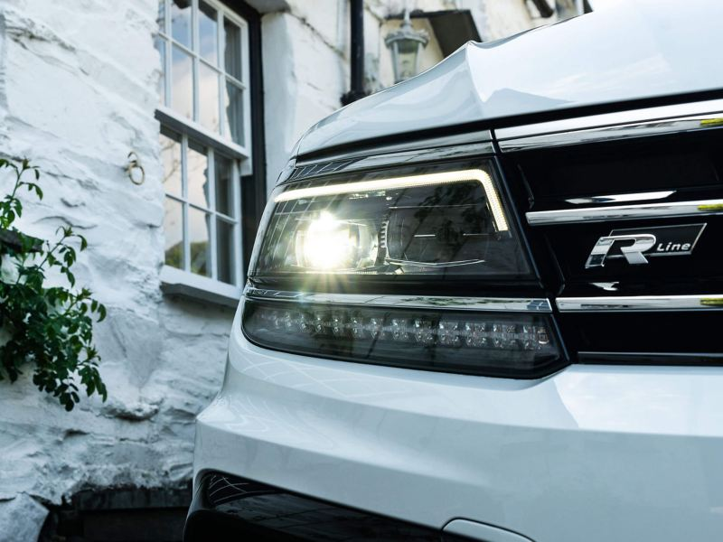 A white Volkswagen Tiguan's LED headlights
