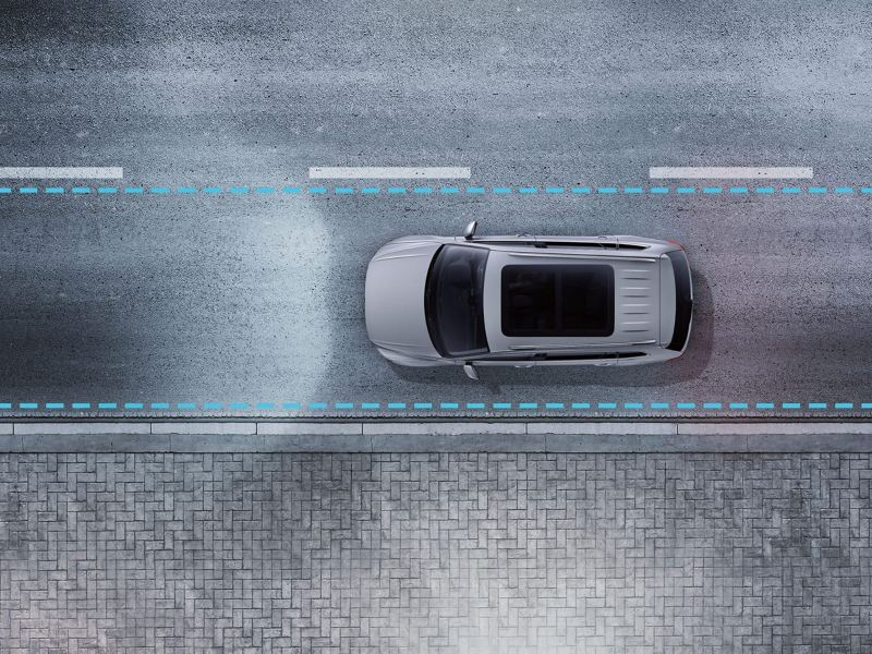 A silver Volkswagen Tiguan Allspace driving on the road with Lane Assist