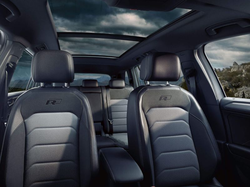 The interior of a Volkswagen Tiguan Allspace showing the seats and the panoramic sunroof