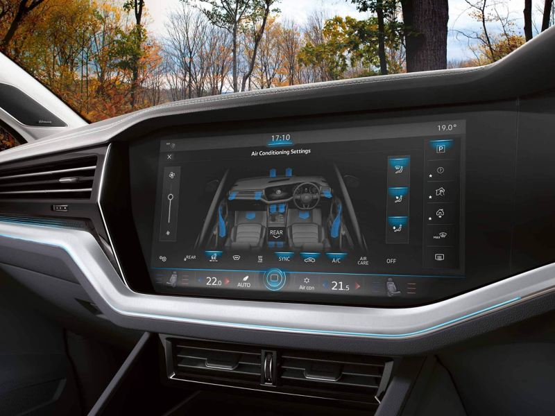 Air conditioning settings on the in-car dashboard screen.
