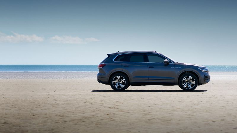 A Volkswagen Touareg parked on the beach.
