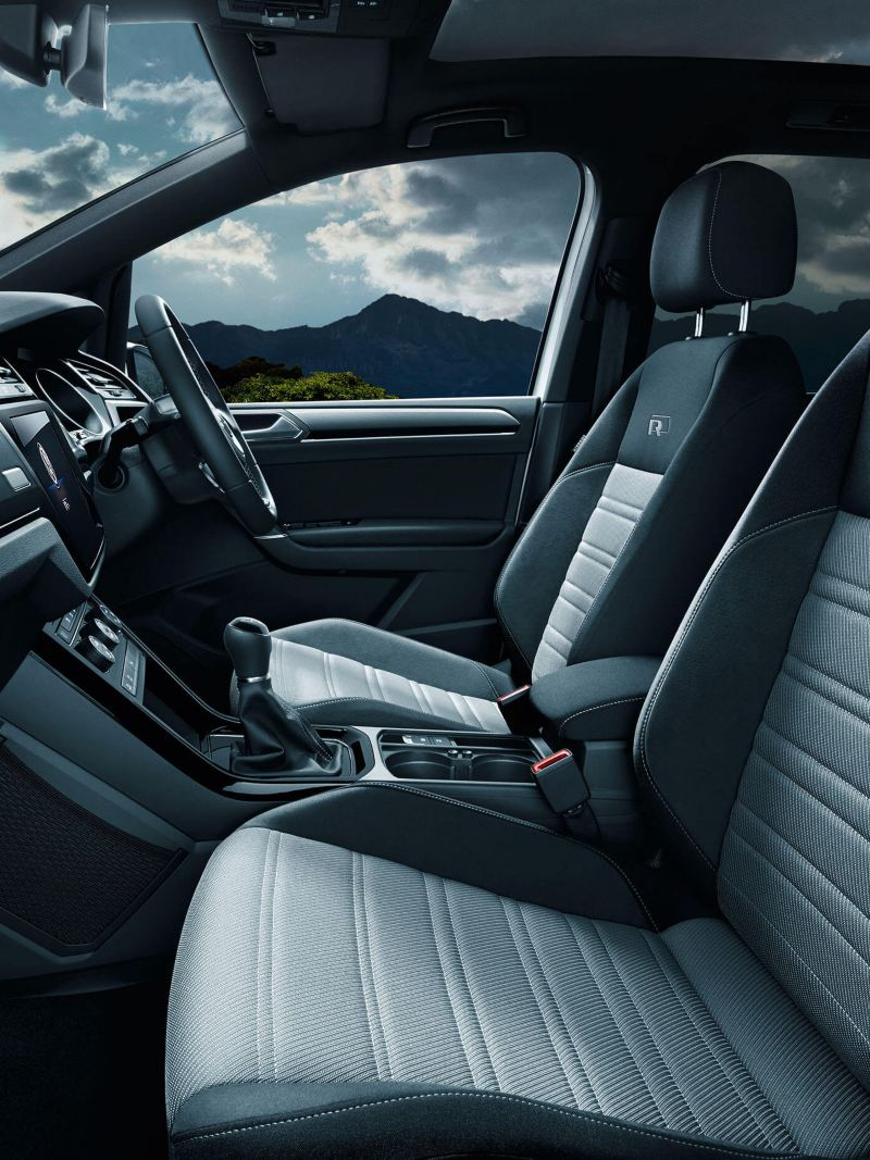 Volkswagen Touran interior with the front seats, steering wheel, dashboard, centre console and gearstick
