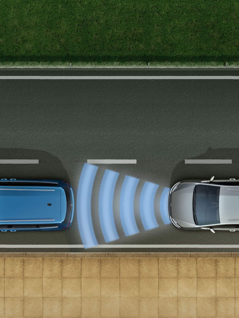 A silver Volkswagen Touran with the Adaptive Cruise Control on while driving behind a blue Volkswagen Touran
