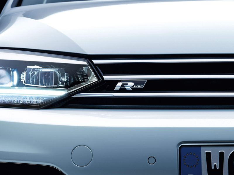 The Volkswagen Touran R-Line badge, headlight and grille