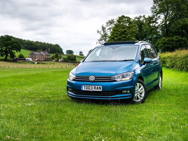 Volkswagen Touran parked in a field
