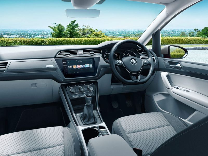 Volkswagen Touran interior with the front seats, steering wheel, dashboard and the centre console showing the Composition Colour Radio