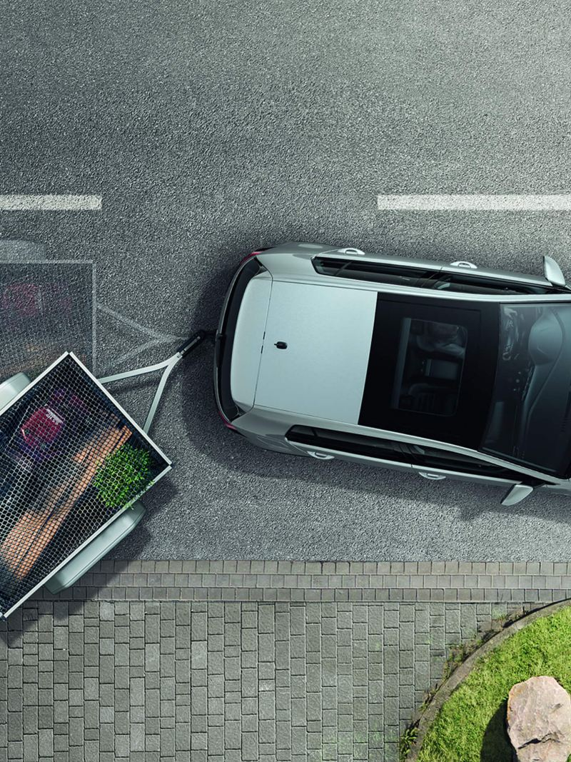 Arial view of Volkswagen Golf Estate Alltrack with a trailer attached, illustrating 'Trailer assist' feature.