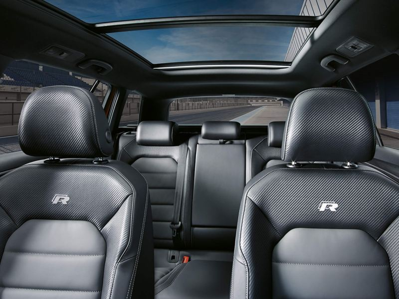 Interior shot of the front and back passenger seats, including sunroof of a Volkswagen Golf Estate R.