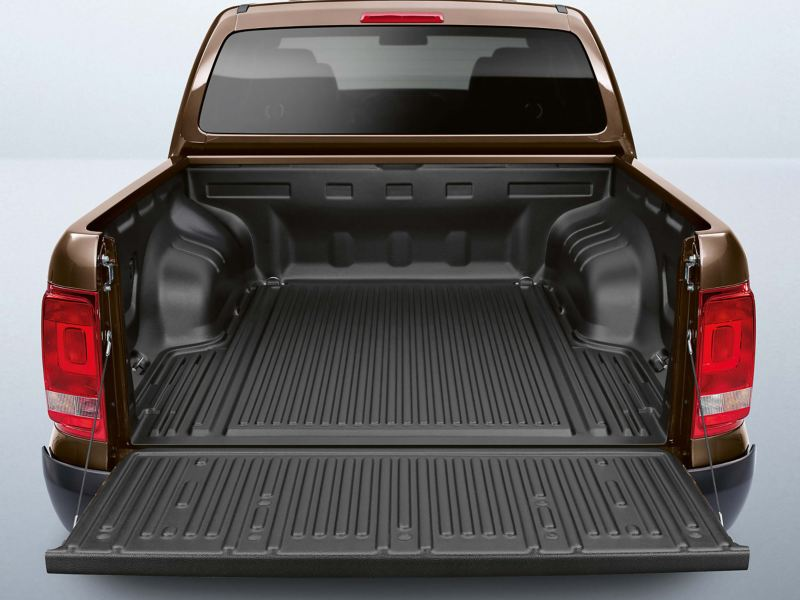 "Open back of brown VW Amaeok pick-up with ""Durabed"" lining"