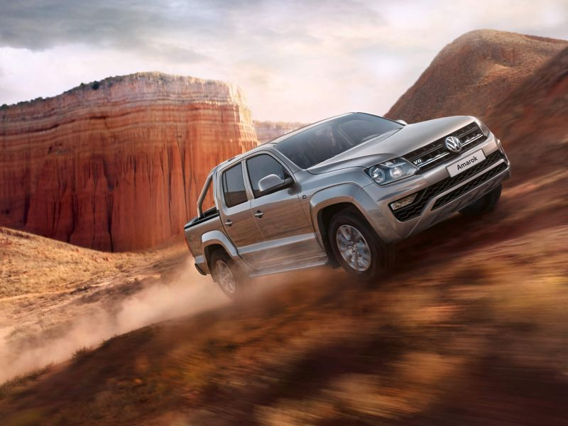 Grey VW Amarok driving off-road on a mountain