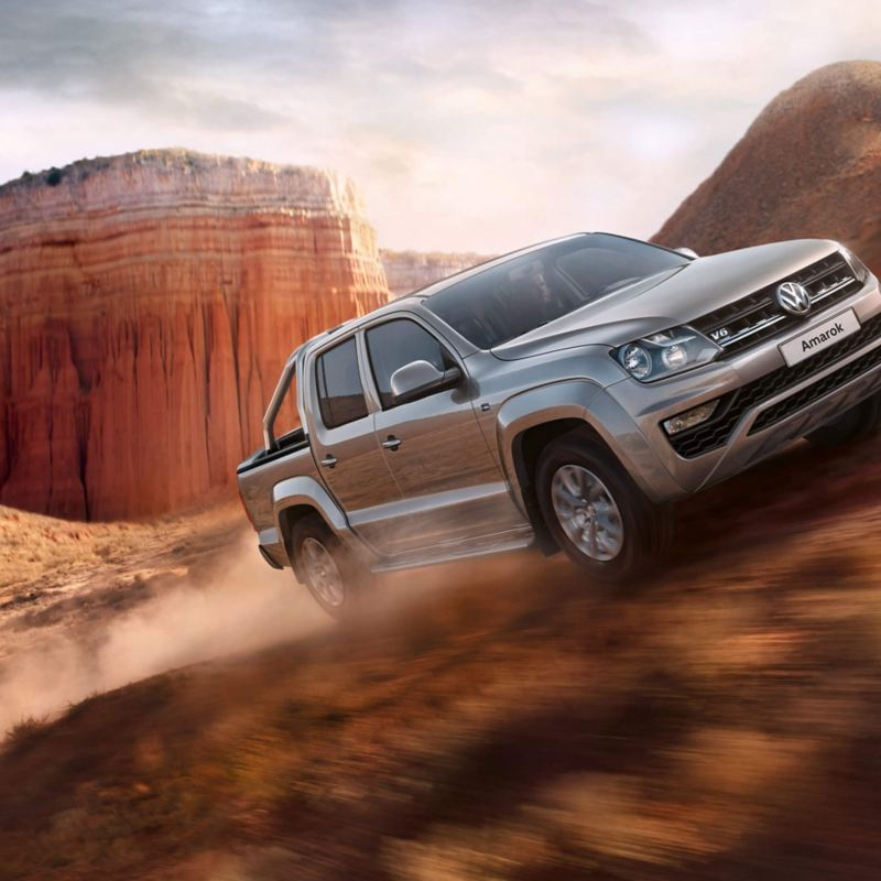 Amarok driving off-road with cliff in background