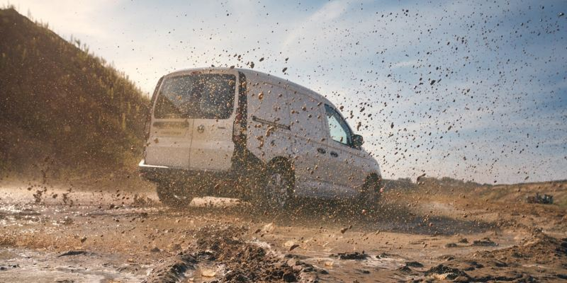 Caddy Cargo van driving in the mud