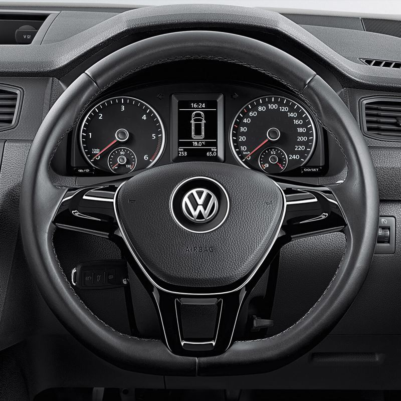 Multi-function leather-covered steering wheel close-up