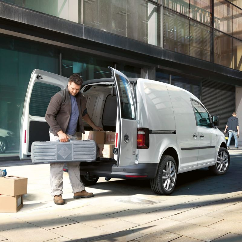 Man loading Caddy panel van