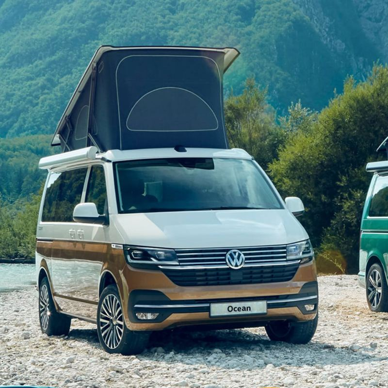 VW California camper vans with pop-up roof by coast