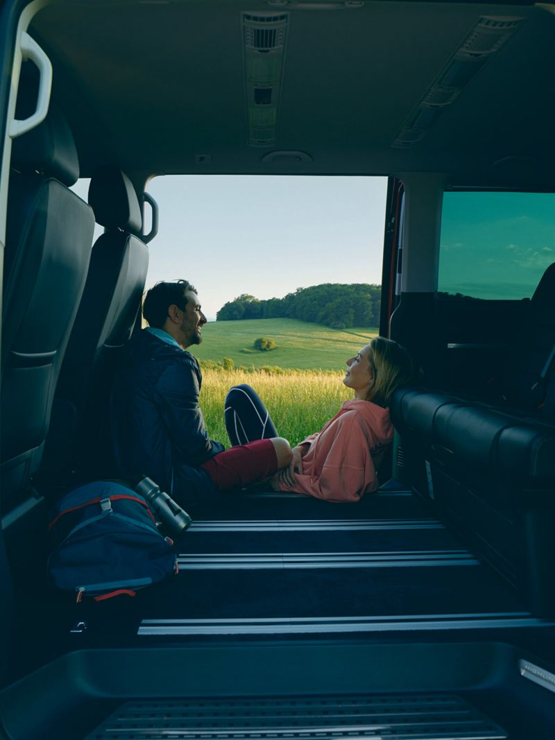 A couple relaxing inside a Caravelle 6.1