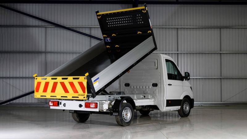 Rear view of crafter tipper, with rear tipping container open