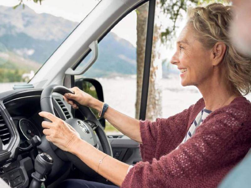 Women driving a Grand California van