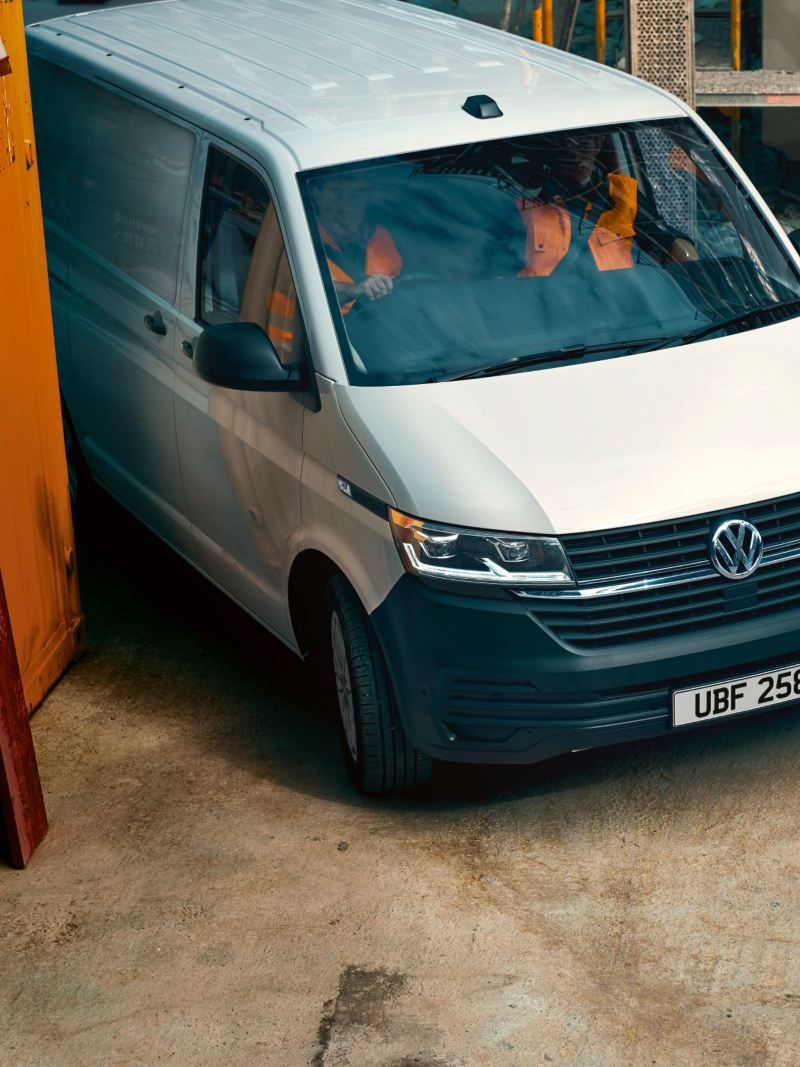 Top view of new VW Transporter 6.1 arriving at building site
