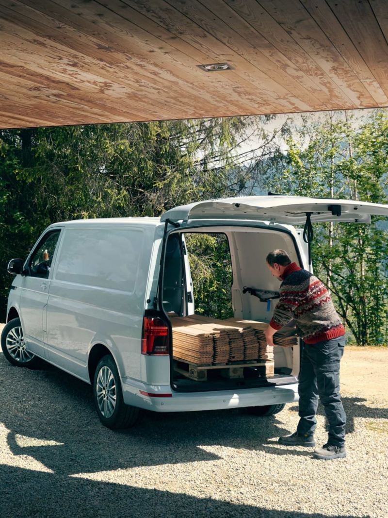 Carpenters unloading wood planks from Transporter 6.1 load area