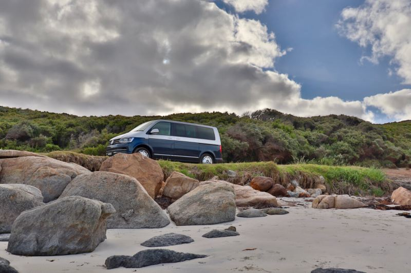 van-driving-by-rocks