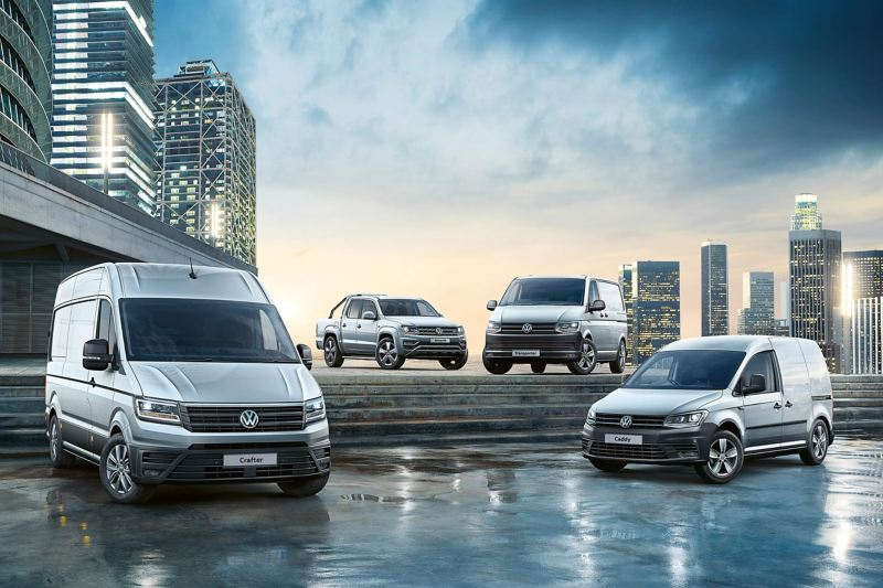 VW Van range on steps in city setting
