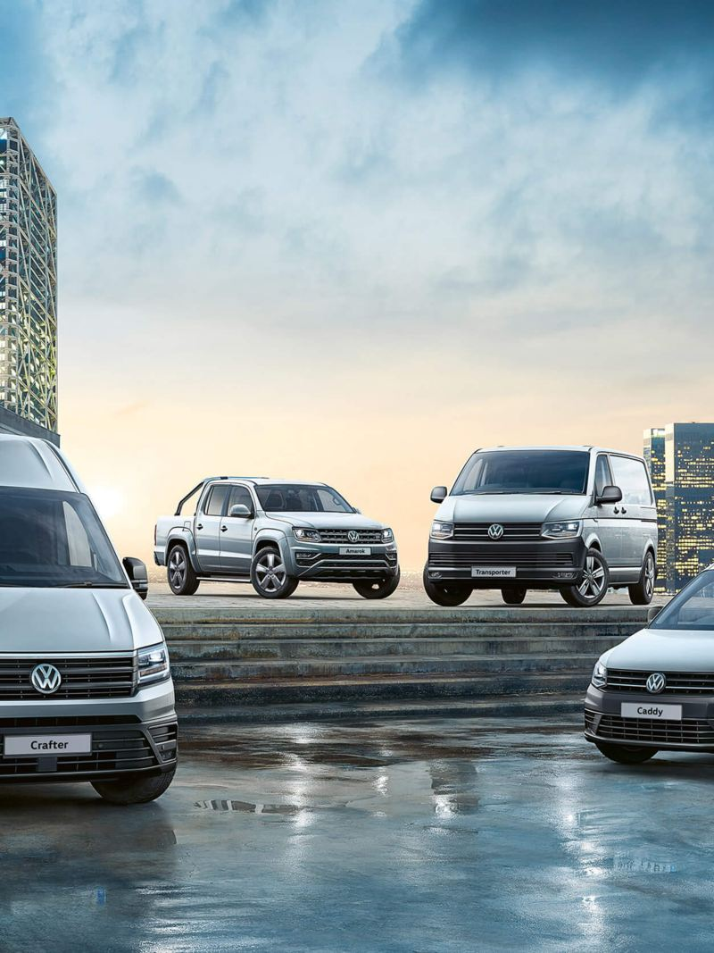 VW Van range on steps in city setting