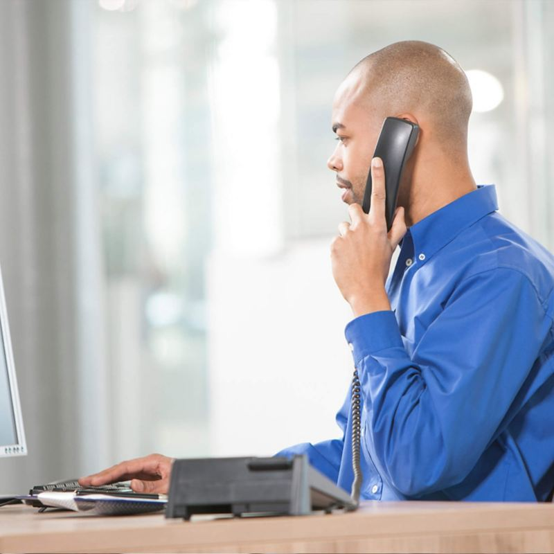 Customer care worker talking on phone