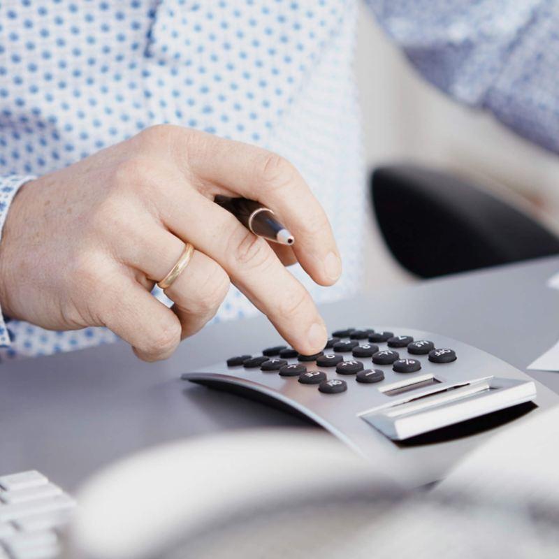 Man using calculator to find van finance