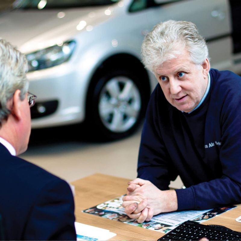 VW Business Development Manager talking to fleet customer in a Van Centre