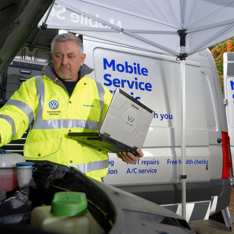 VW Mobile Service technician fixing van