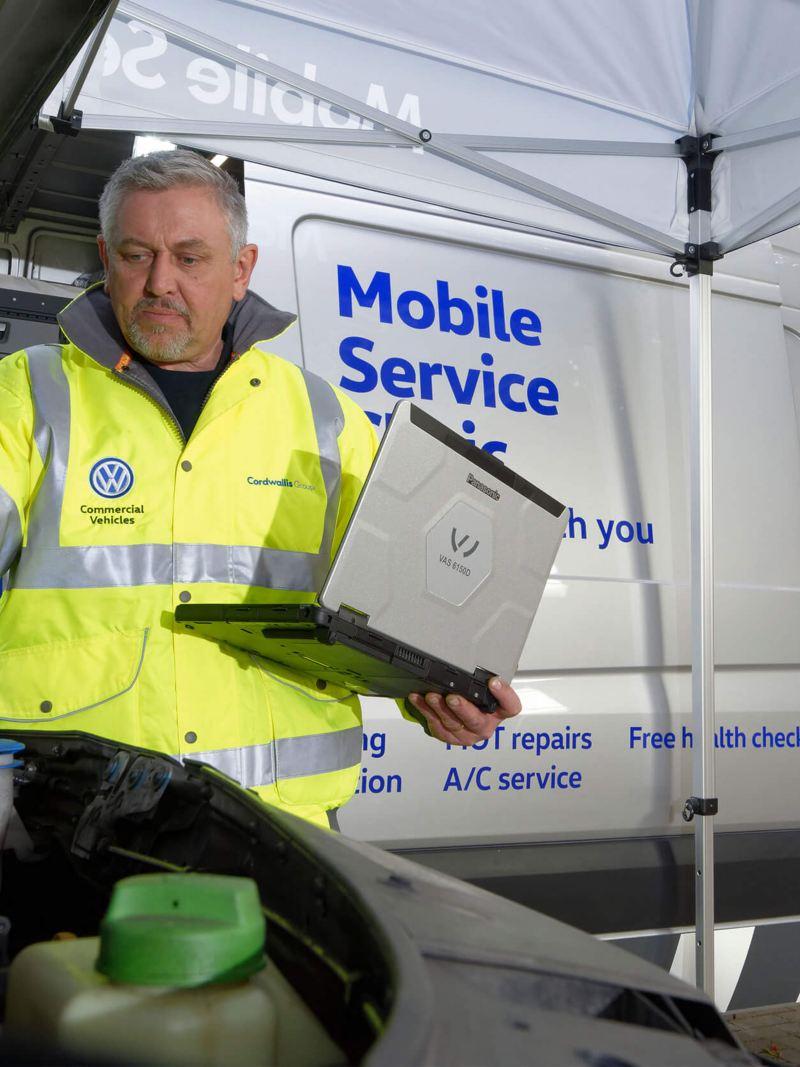 VW Mobile Service technician fixing van