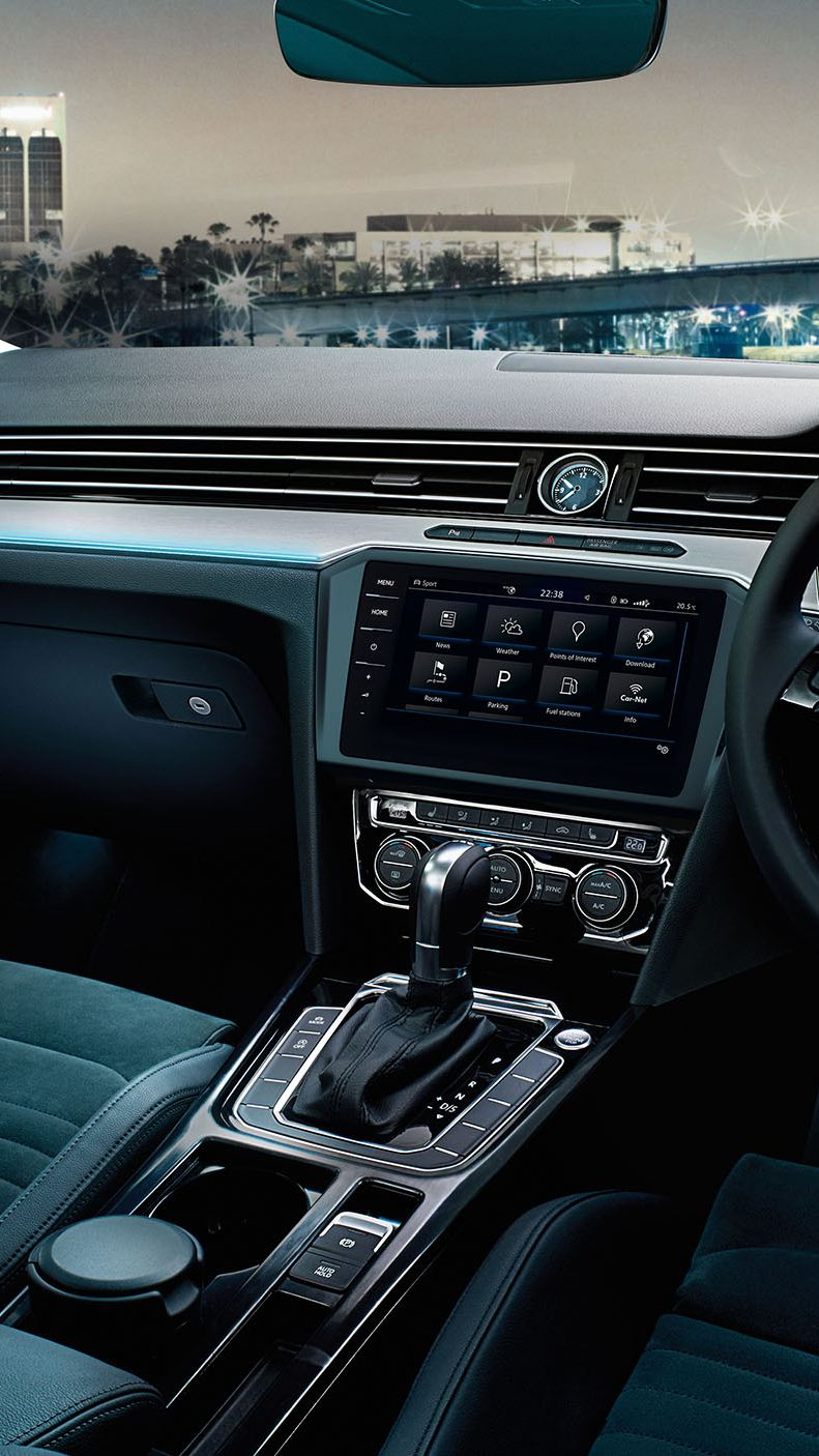 Interior of a Volkswagen Passat, dashboard and steering wheel.