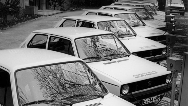 A row of parked electric Golfs