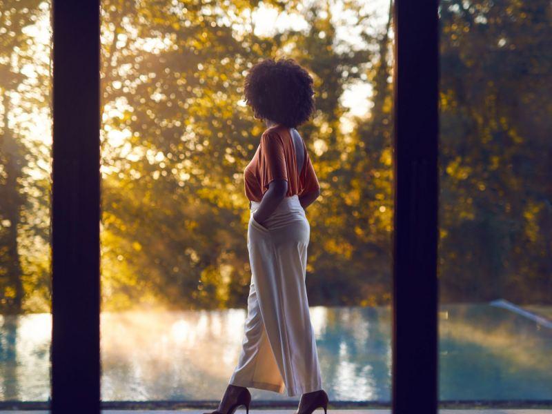 Lady looking outside a window