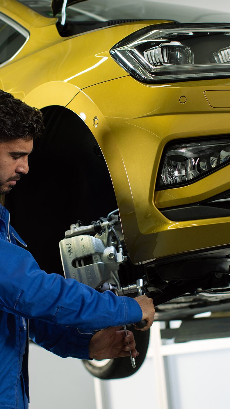 Volkswagen technician looking at car
