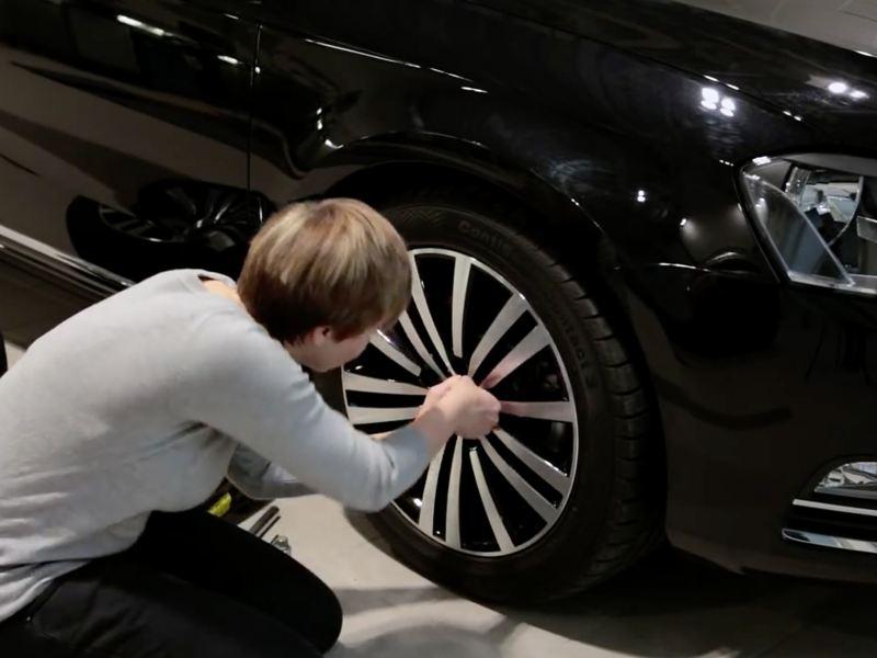 Man touching tyre