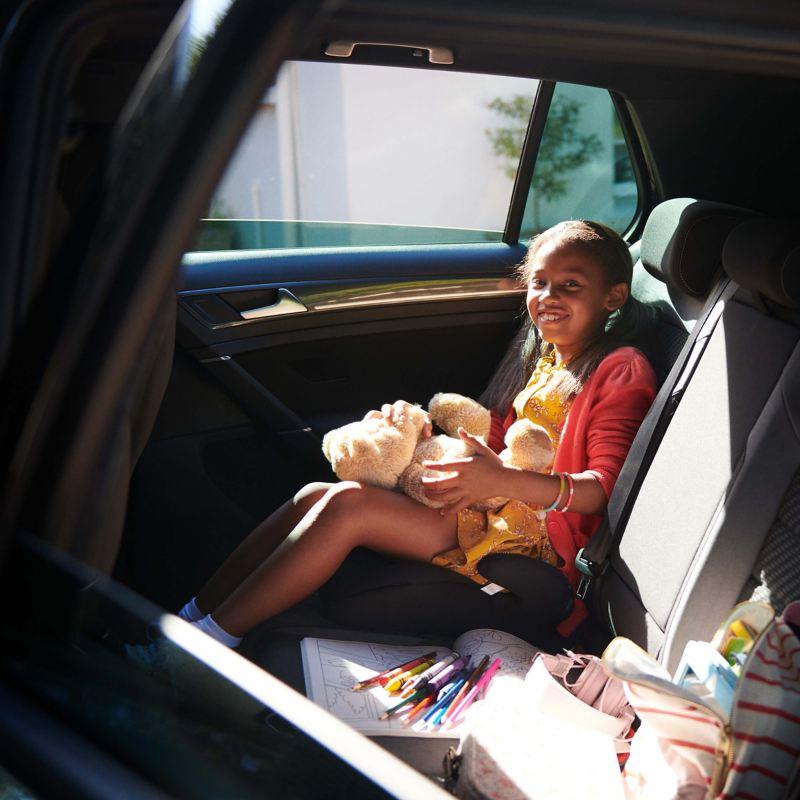 Girl sitting in a Volkswagen car