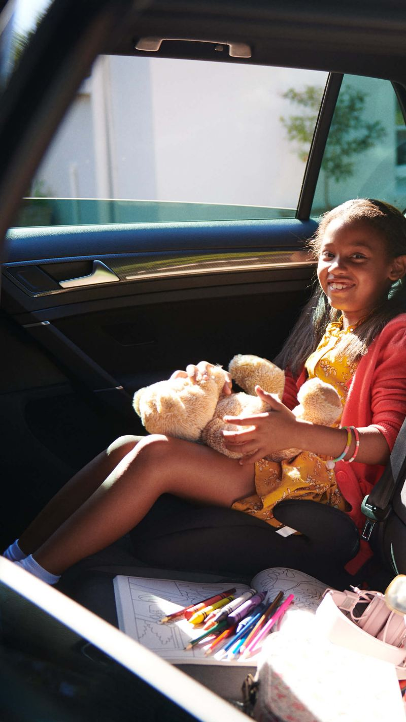 Girl sitting in a Volkswagen car