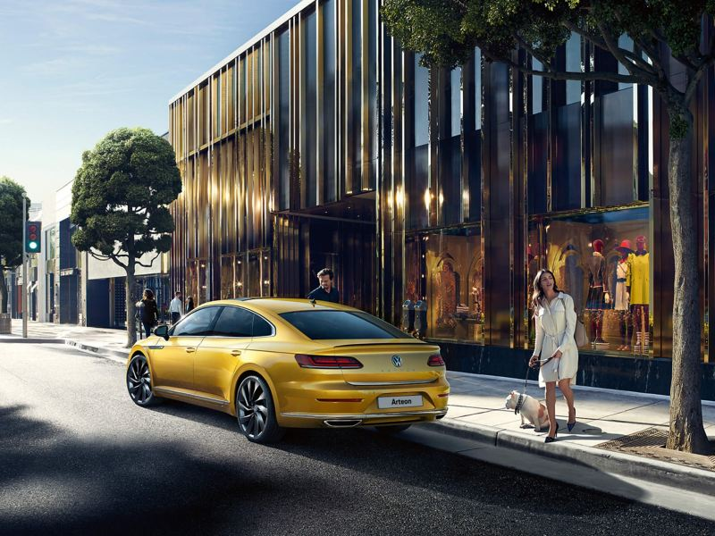 An Arteon parked on a city road