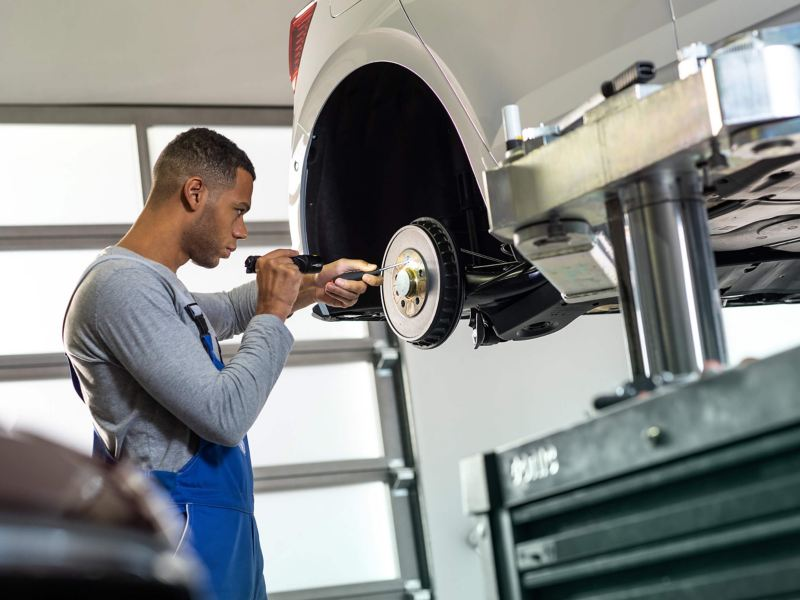 Volkswagen technician fixing car