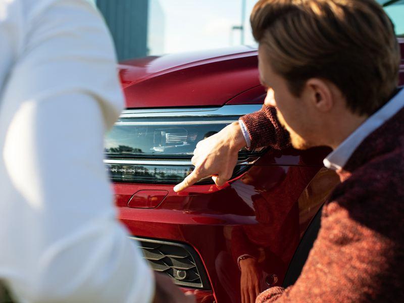 Volkswagen technician examining car