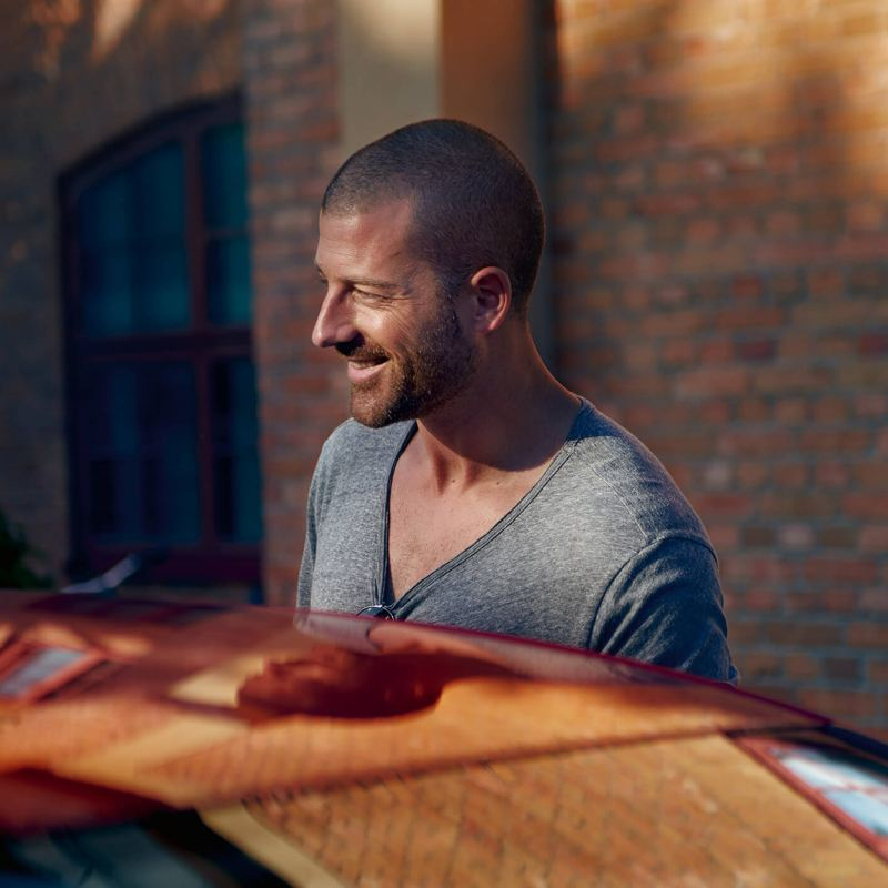 A man with a Volkswagen car