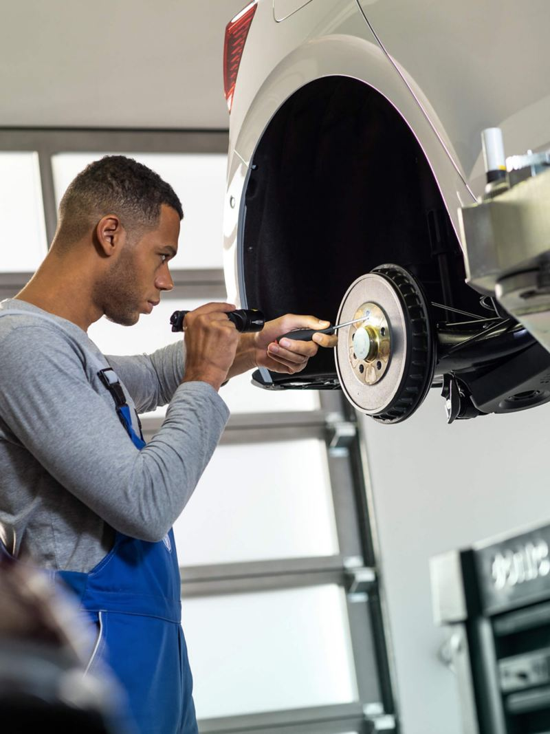 Technician servicing a Volkswagen car